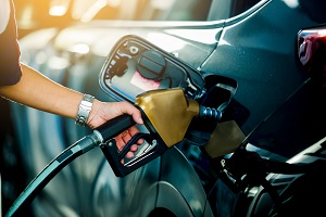 Hand refilling car with gas