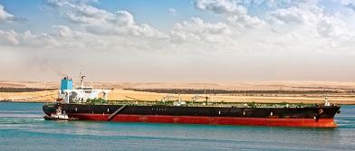 Tugboat Assisting Supertanker Image